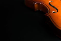 Violin Silouhette on dark background. With space for text on the left Stock Images