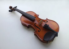 Violin. Small violin and white background Royalty Free Stock Photos
