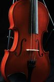 Violin. On a stand. Photographed in low key Stock Photography