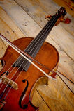 Violin still life. Closeup take of a violin on a wooden background Stock Image