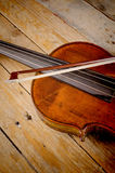 Violin a string instrument. Closeup take of a violin on a wooden background Stock Photography