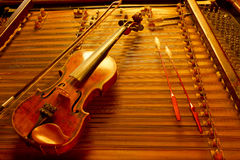 Violin string instrument. Two music string instrument  in gold light Stock Photography