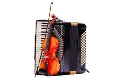 Violin stuck to the accordion. Accordion with violin. royalty free stock images