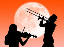 Violin and trumpet players in the moon Stock Photo