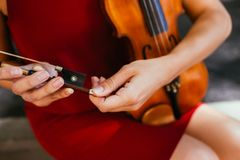 Violin tuning classical music instrument. Violin tuning. classical music. woman check her instrument before playing it concept Royalty Free Stock Photos
