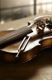 Violin and tuning fork. Still life photography of violin and tuning fork Royalty Free Stock Image