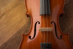 Violin in vintage style on wood background stock photography
