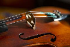 Violin in vintage style on wood background close up royalty free stock photo