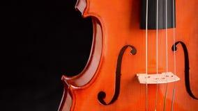 Violin or viola gyrating at black background stock video footage