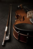Violin with violin bow. On the black background Stock Photo