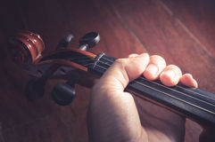 Violin in Violinist's hand,vintage filtered. royalty free stock images