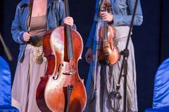 Violin and violoncello in women hands on concert. Women violinist and cellist with Violin and violoncello in women hands on concert stock images