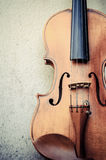 Violin on a wall Stock Images