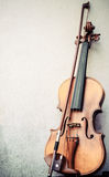 Violin on a wall Stock Photo