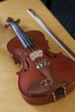 Violin with wedding rings Stock Image