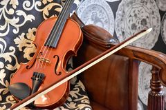 The violin which was put in the room. The violin which was put in the sofa of the room Stock Photos
