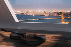 Violin on windowsill. Side view of violin placed on wooden windowsill. Window with city view and sunlight in the background. 3D Rendering Stock Photo