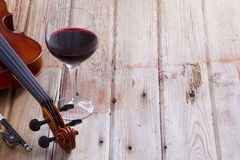 Violin and Wine on Wooden Floor with Copy Space Royalty Free Stock Photo