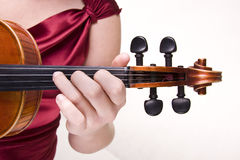 Violin in woman's hand Royalty Free Stock Photos