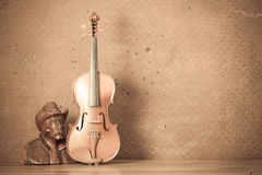 Violin with Wood carving. On steel background Royalty Free Stock Image