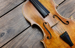 Violin on a wooden background Stock Image