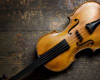 Violin on wooden background Royalty Free Stock Photos