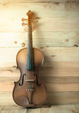 Violin on wooden background Royalty Free Stock Image