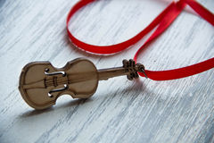 Violin on wooden grey background Royalty Free Stock Photos