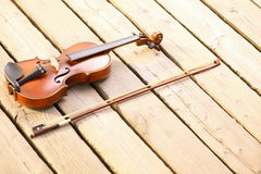 Violin on wooden pier. Music concept Royalty Free Stock Photos