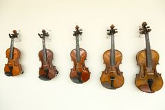 Violins. The violin is a wooden string instrument in the violin family. It is the smallest and highest-pitched instrument in the family in regular use. Smaller royalty free stock photo