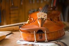 Violin workshop. A violin in workshop Royalty Free Stock Photos