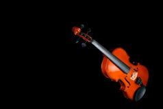 Violine auf schwarzem Hintergrund Stockfotos