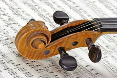 Violine on a note sheet. Detail from an old violine on a note sheet Royalty Free Stock Photo