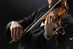 The violinist. Musician playing violin on dark background Royalty Free Stock Photos