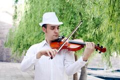 Violinist. A male violinist playing and looking at the violin Stock Photo