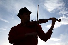 Violinist. A silhouette of a male violinist playing the violin Stock Photography