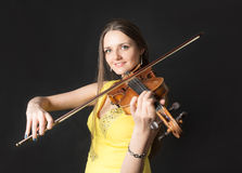 Violinist on black background Stock Photos