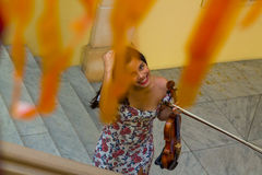 Violinist caught unaware. Girl violinist taken by surprise smiles at the camera Royalty Free Stock Images