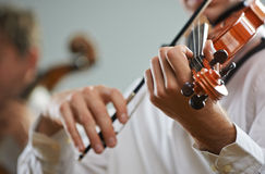 Violinist and cellist. Violinist playing at the concert, close up Stock Image