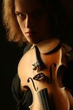 Violinist dark portrait on black Stock Photos