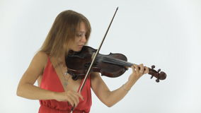 Violinist emotionally plays on her musical. Violinist in beautiful long dress emotionally plays on her musical instrument stock video