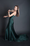 Violinist in an evening dress Stock Image
