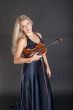 Violinist in an evening dress Royalty Free Stock Photo