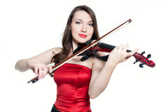 Violinist girl in red dress Stock Images