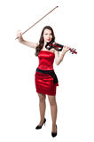 Violinist girl in red dress Royalty Free Stock Photos