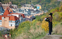 Violinist on the hill royalty free stock image