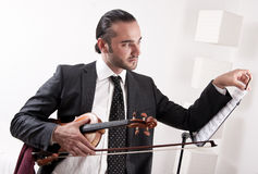 A violinist with his violin Royalty Free Stock Image