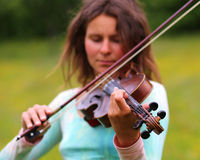 Violinist on a meadow Stock Photography