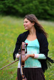Violinist on a meadow Royalty Free Stock Photos