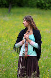 Violinist on a meadow full of flowers Stock Image